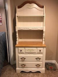 White wooden cabinet with book shelf