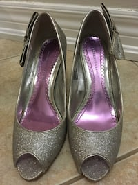 Pair of High heels silver shoe. Size is 7.