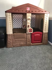 toddler's brown and beige Step 2 house play set