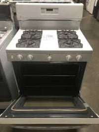 (Similar to picture it's not the actual one)White and black gas range oven Maple Ridge, V2W 1S4