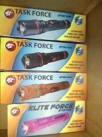 four assorted-color Task Force flashlight boxes