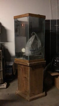 30 some gallon  aquarium. used, comes with, stand, filter  and brown gravel El Paso, 79925