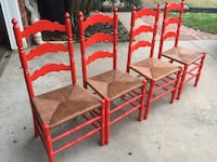 4 red wooden chairs