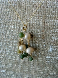 gold and green gemstone pendant necklace