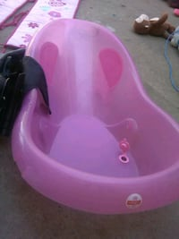 baby's pink plastic bather 2290 mi