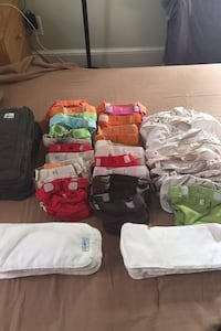 Cloth diapers with liners and pads