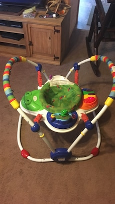 baby's green and red jumperoo