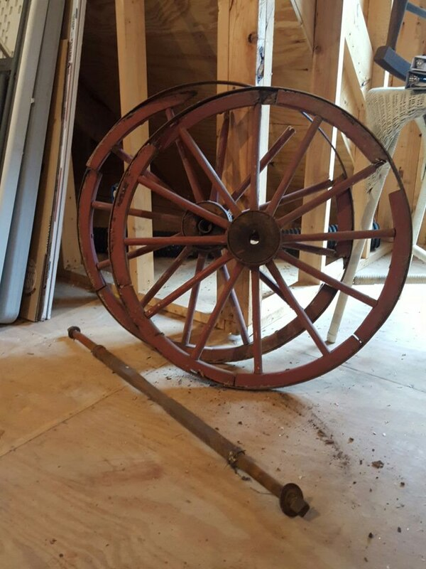 Antique wooden wagon wheels and axle