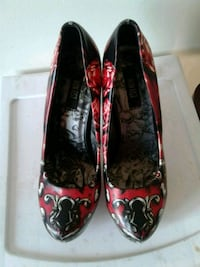 pair of red-and-black leather pumps Brandon, R7A 6X9