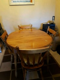 oval brown wooden dining table with four chairs set St. John's, A1A 2H3