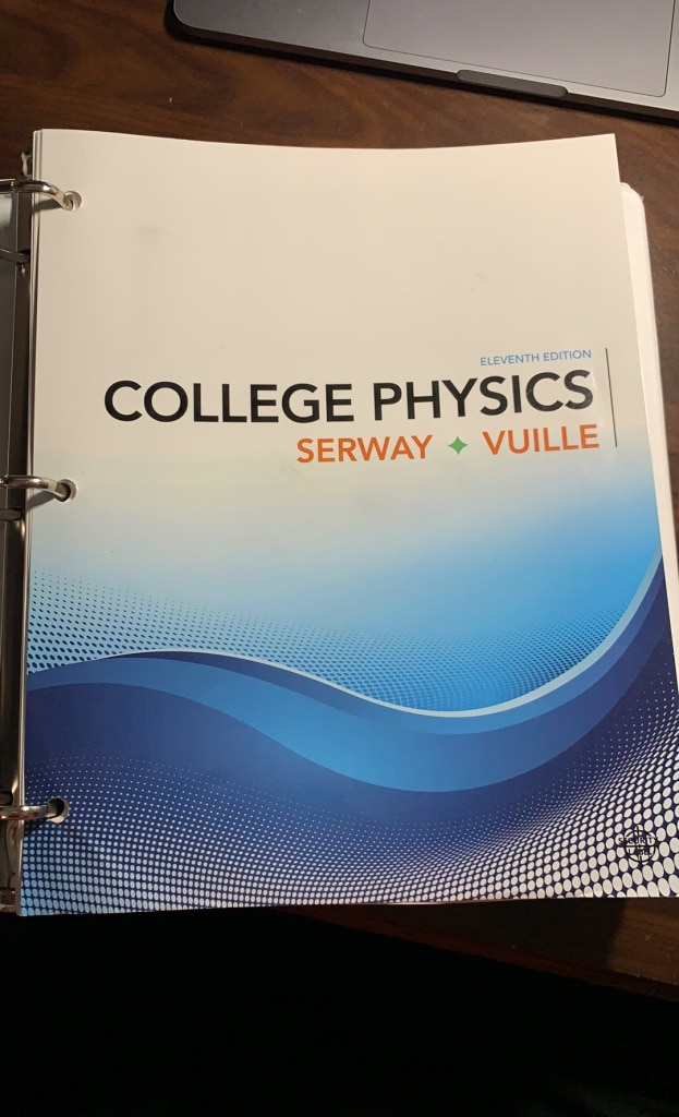 Photo College Physics Textbook, Serway Vuille 11th Edition -Loose-Leaf Paper