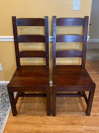 A pair of wooden chairs