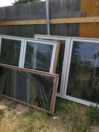 two brown wooden framed glass windows Amarillo, 79106