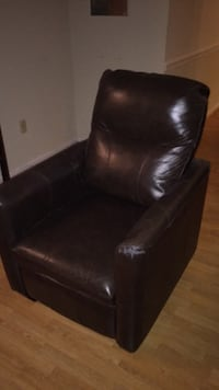 Black leather padded recliner/ chair 64 km