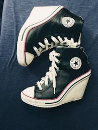pair of black-and-white Converse high tops Queens, 11373
