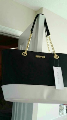 black and white leather Kenneth Cole Reaction tote bag