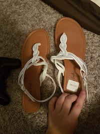 pair of brown-and-white leather t-strap sandals Winnipeg, R3R 2Z2