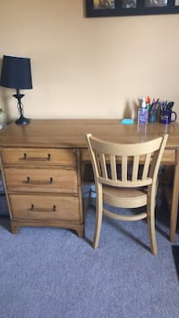 brown wooden single-pedestal desk 200 mi