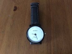 round black framed analog watch with black leather strao