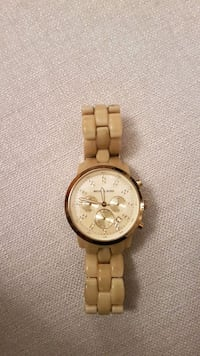 round gold chronograph watch with link bracelet Montréal, H4A 1Y2