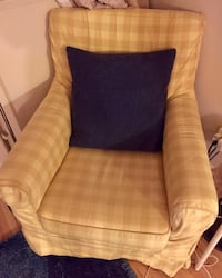 Armchair with throw pillow