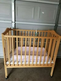 baby's brown wooden crib Houston, 77021