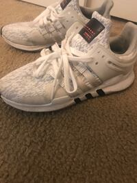pair of white Adidas running shoes