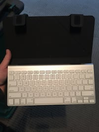 white wireless keyboard; black leather tablet computer case Surrey, V3X 2Z4