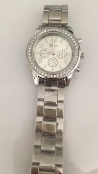 round silver chronograph watch with silver link bracelet Edmonton, T6V 0H6