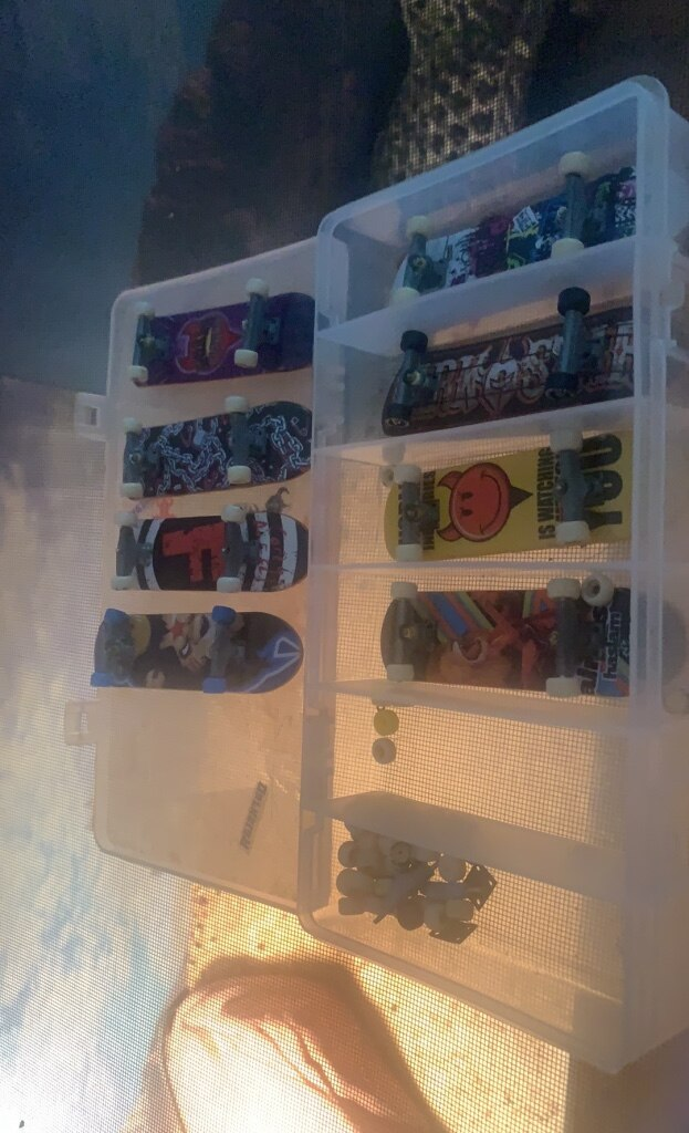 Photo 8 tech decks with spare wheels and trucks.