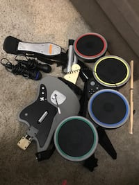two black and gray guitar hero controllers