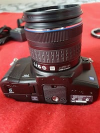 Olympus DSLR camera with accessories