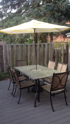 black steel frame rectangular patio table with canopy umbrella