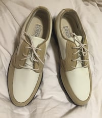 pair of brown Sperry boat shoes