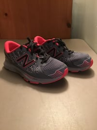 Red and grey new balance 690.  boys/young men's size 7.  Looks pink, but it's red.  Lighting is off.