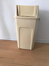 Trash can with swing lid. Beige and plastic.