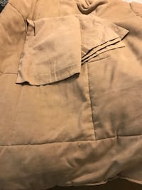 Double bed tan comforter and shams. Feels similar to microfiber. Pick up only. Sarasota, 34241
