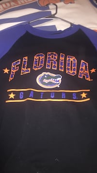 black, blue, and yellow Florida Cators crew-neck shirt