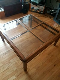 rectangular brown wooden framed glass top coffee table Calgary, T2C 4V2