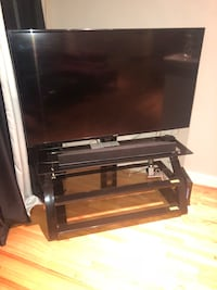 65 in Samsung smart tv and tv stand with mount included. Houston, 77063