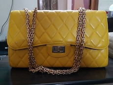 yellow quilted leather shoulder bag