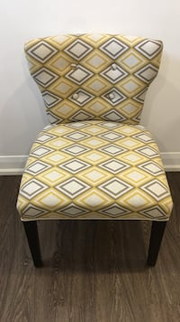 white and yellow designer fabric padded chair