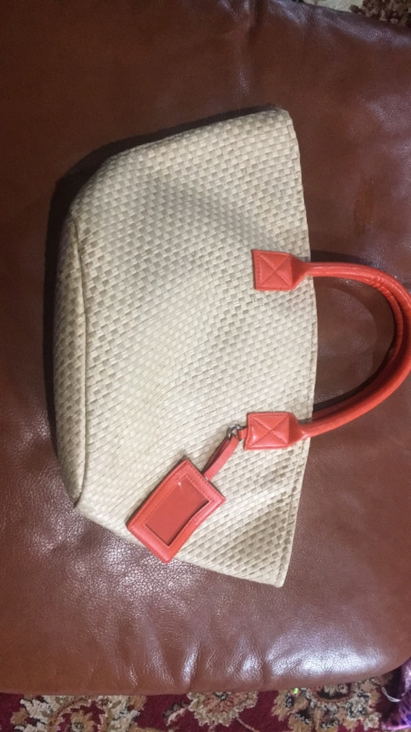 gray and red leather tote bag