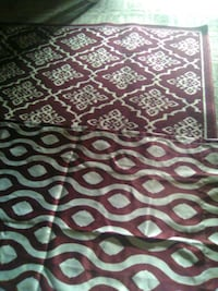 Area rug and curtain panels