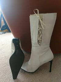 pair of white leather snip-toe stiletto knee-high boots