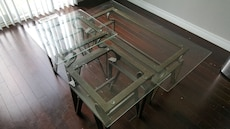 clear glass-top with black steel base center table and side table