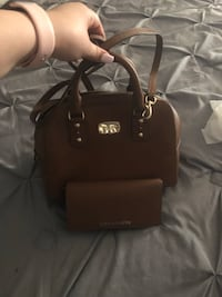 like new mk purse with wallet, very well taken care of. has a long strap to be used on a side too. Midland, 79706