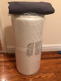 New Twin mattress with cover,  221 mi
