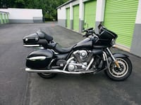 black and gray touring motorcycle 14 km