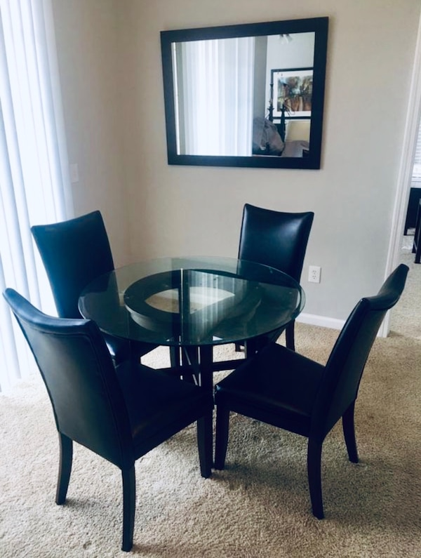 Glass dining room table and 4 black leather chairs Round table top 42\